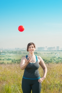 Woman exercising with ball